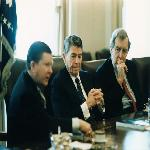 President Reagan receives the Tower Report in the Cabinet Ro